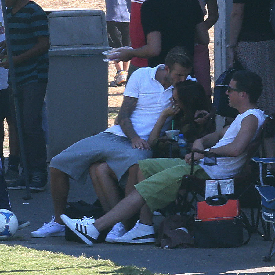 David Beckham planted a kiss on Victoria while watching their boys play soccer in LA in September.