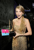 Taylor Swift held on to her American Music Award while backstage at the event in November 2011.
