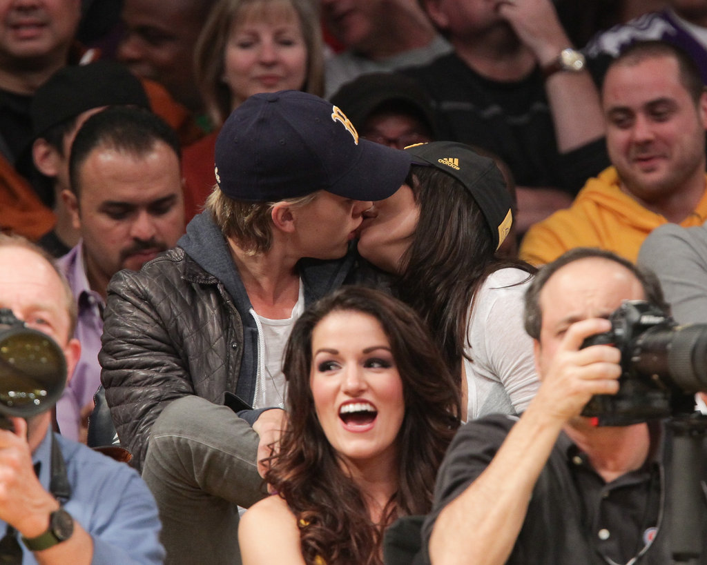 Vanessa Hudgens and Austin Butler took their eyes off the court and swapped a peck during a January Lakers game.