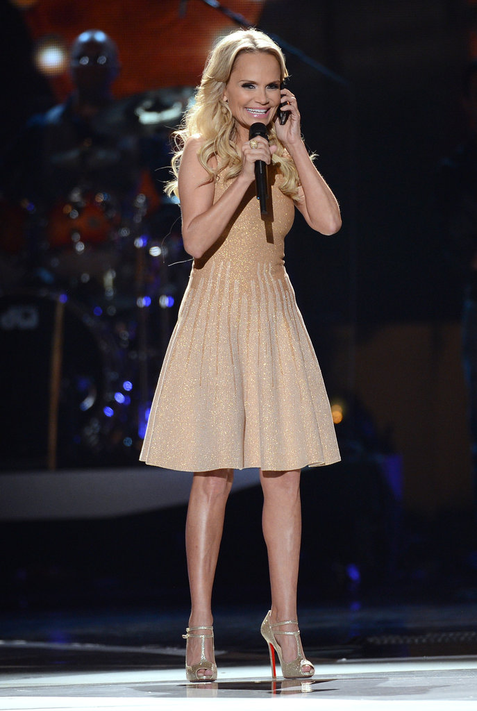 Kristin Chenoweth took a call while hosting the American Country  Awards.