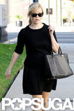 Reese Witherspoon paired a black skirt with a black top.