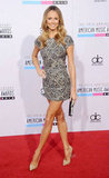 Stacy Keibler showed off her long legs at November's American Music Awards in an embellished minidress by Collette Dinnigan.
