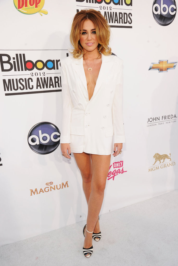 Miley Cyrus took the risqué route at the Billboard Awards in May, wearing a Jean Paul Gaultier ivory double-breasted jacket and minidress.