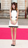 Alexa Chung had a string of minidress moments this year, but this look from May is one of our favourites — the style setter offset her black and white Moschino dress with a chic pair of ankle-strap flats and a sweet printed clutch.