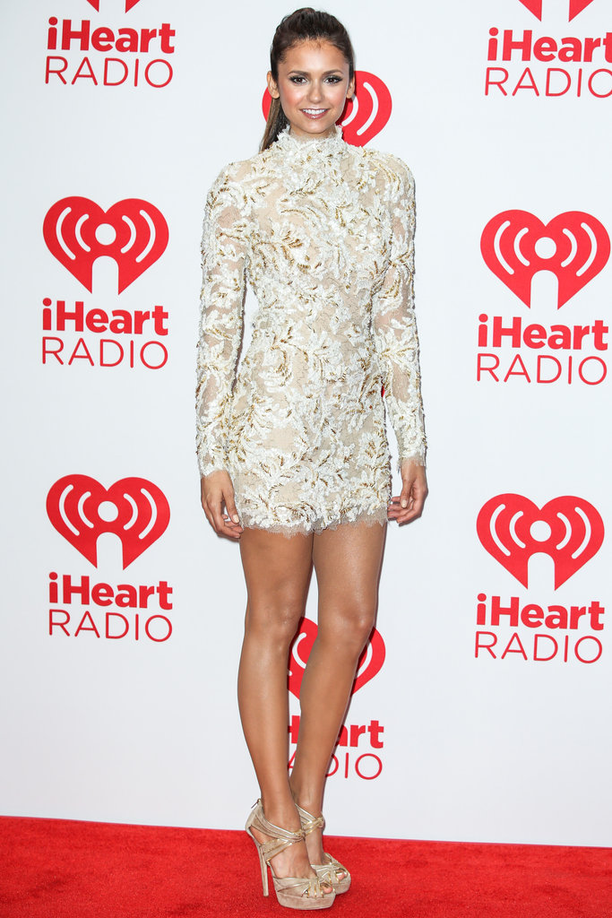 Nina Dobrev pulled out all the stops at September's iHeartRadio Music Festival, hitting the red carpet in a cream-colored lace dress from Zuhair Murad's Couture collection.