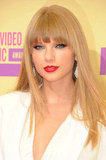 This year was all about redefining her beauty look. Taylor worked the 2012 MTV Video Music Awards red carpet in a white suit with a plunging neckline. She stayed true to her red lips and winged liner preferences but remained committed to her straightened hair and face-framing bangs.