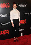 Girls star Zosia Mamet attended the event wearing a high-collar blouse with black trousers and red platform pumps.