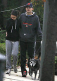 Ashton Kutcher and Mila Kunis took their dog for a walk.