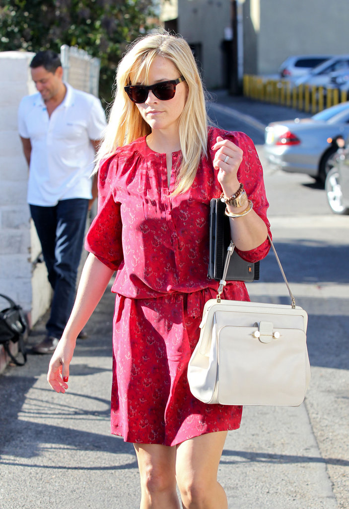 Reese Witherspoon carried an iPad under her arm.