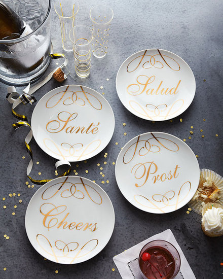 "She'll be able to use these festive ""cheers"" dessert plates ($48 for four) throughout the holiday season — and for just about any celebration after that."