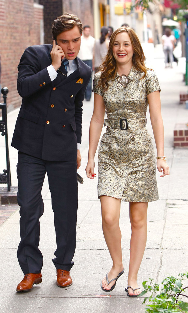 Leighton Meester cracked a smile during a stroll down a Manhattan street with costar Ed Westwick in June 2009.