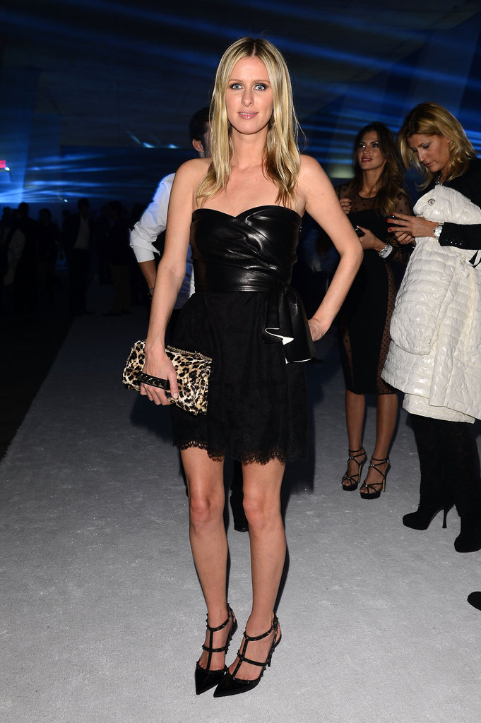 Nicky Hilton perfected partywear in a leather and lace strapless dress and luxe Valentino add-ons.