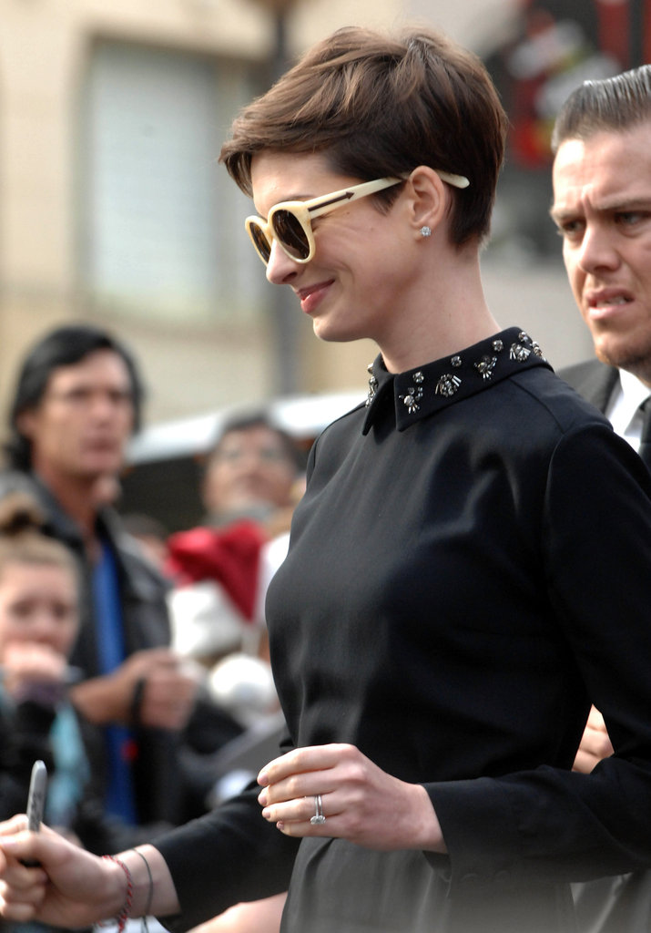 Anne Hathaway topped off her Prada dress with round Karen Walker shades.