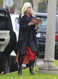 Gwen Stefani carried a cake into a friend's house.