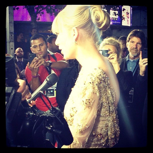 We could resist snapping this photo of Taylor Swift's impressive updo and golden gown at the AMAs in LA.