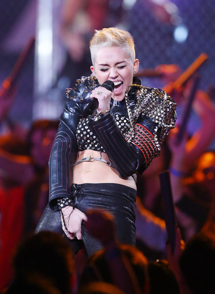 Miley Cyrus wore an outfit that featured metal body jewelry and studs.
