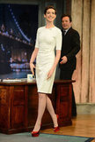 Anne Hathaway gave her little white Cushnie et Ochs sheath a touch of seasonal styling with a pop of red on her heels.