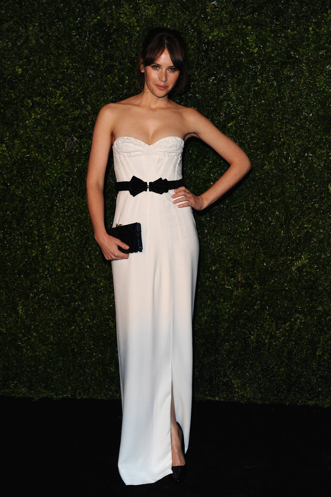 Felicity Jones was a knockout in striking white Burberry Prorsum, finished with a contrasting black bow at the waist.