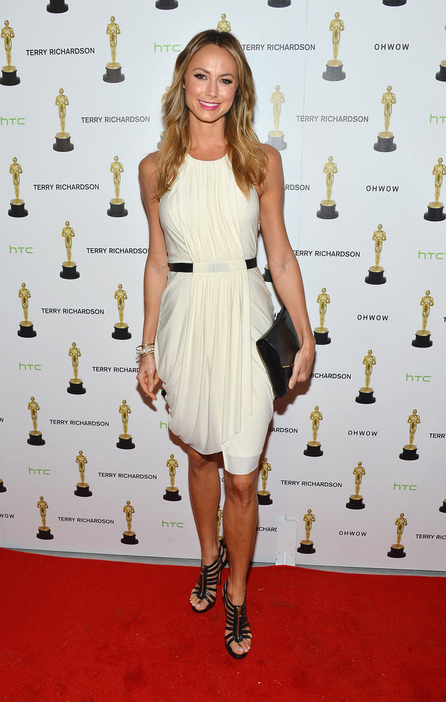 Stacy Keibler gave cocktailwear a chic twist in a draped, cream-colored sheath and strappy pumps.