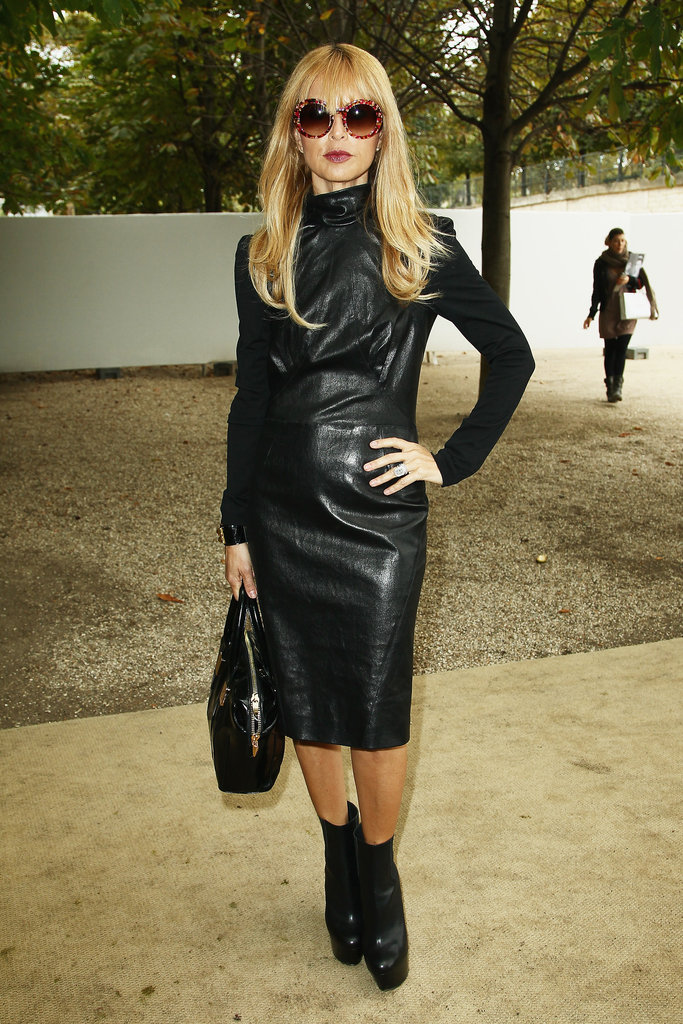 Rachel Zoe showed off a sophisticated leather look during Paris Fashion Week in a knee-length leather dress with a high neckline. The bondage-style sheath commanded lots of attention.