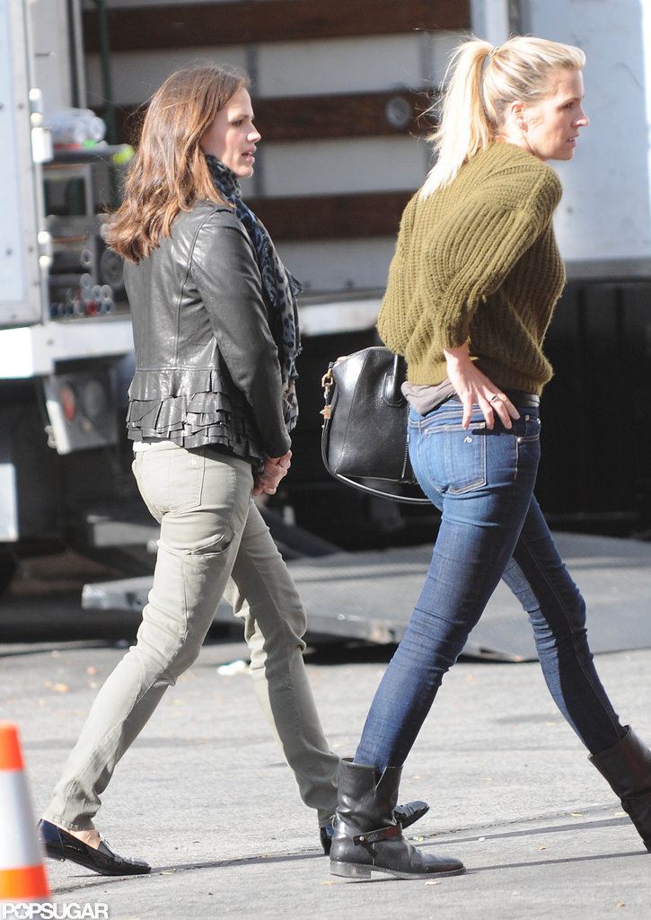 Jennifer Garner wore army green pants and a leather jacket.