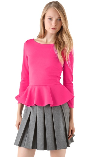 Brighten up your Winter blues with this punchy Alice + Olivia longsleeve pink peplum top ($264). We would wear it with black or oxblood leather pants for major texture.
