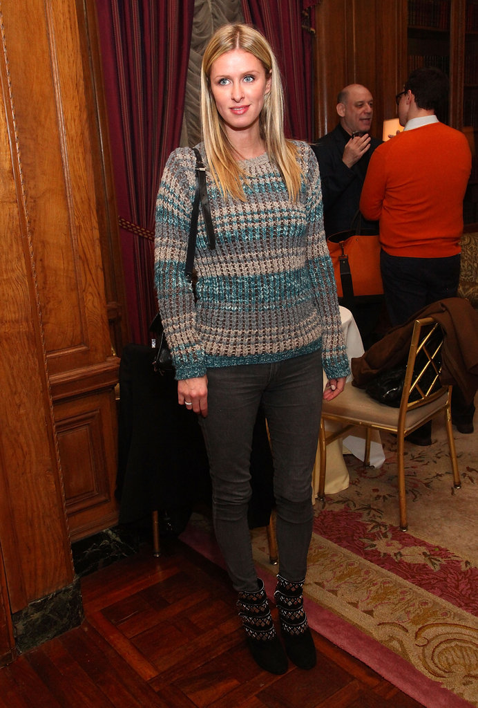 Nicky Hilton dressed up a knit with leather pants and embellished booties.