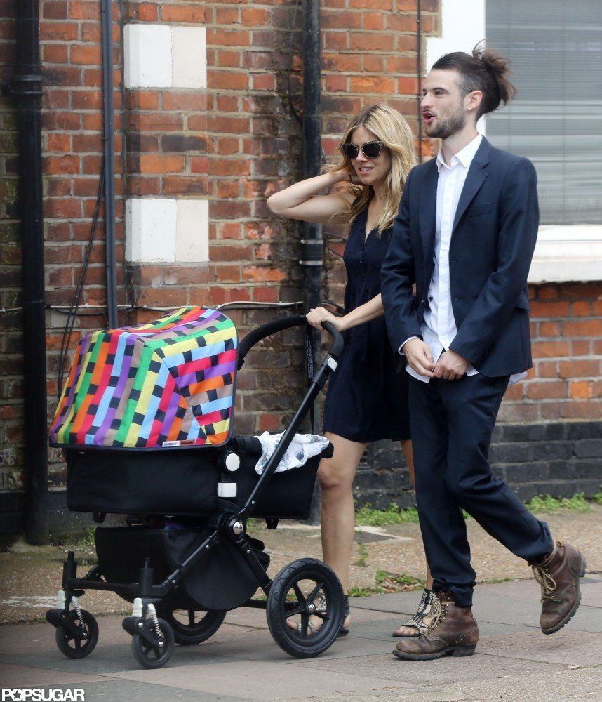 Tom Sturridge and Sienna Miller went for an August 2012 walk around London with baby Marlowe.
