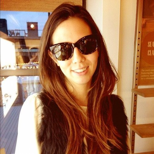 Associate Editor Marisa tried on a sleek pair of TOMS shades.