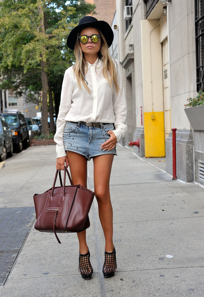 During Summer, this girl was snapped completing her denim shorts and silky white blouse with an oxblood Céline Luggage Tote.