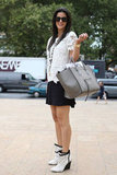 Her soft gray crocodile Céline tote blended flawlessly with her chic black and white look.