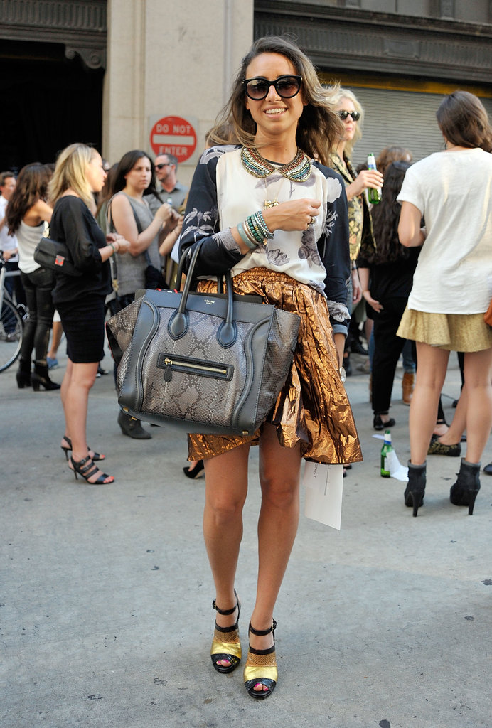 This street styler's snakeskin Céline Luggage tote stood out even against her funky look — we love her crinkly bronze skirt.