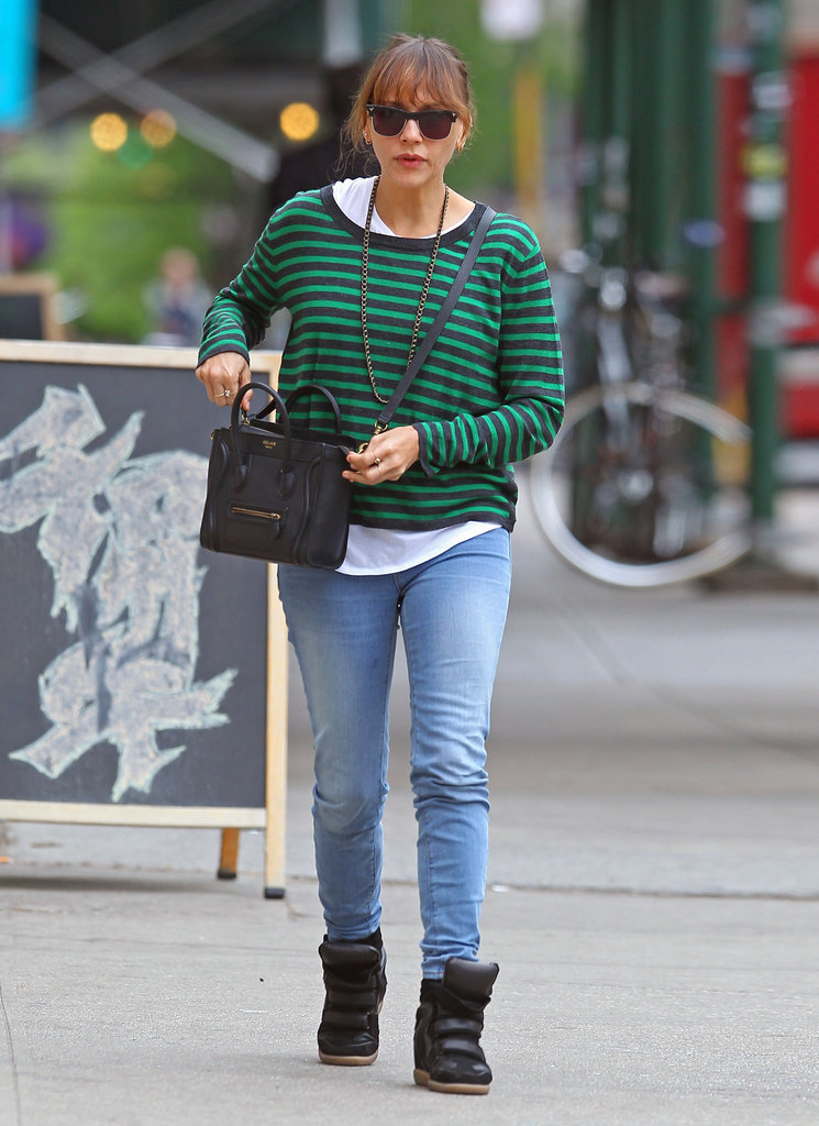 While roaming NYC's East Village, Rashida Jones kept things laid back in black Isabel Marant sneakers, denim skinnies, and a bright striped sweater.