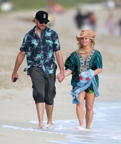 Eric Johnson and Jessica Simpson held hands as they walked on the beach in Hawaii in December 2012.