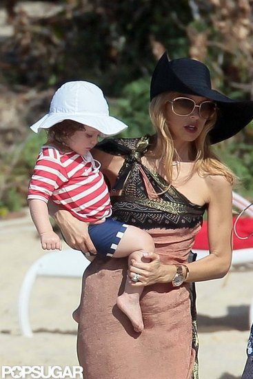 Rachel Zoe and Skyler covered up on the beach.