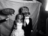 CaCee Cobb and Donald Faison posed in a photo booth during their wedding reception. Source: Twitter user zachbraff