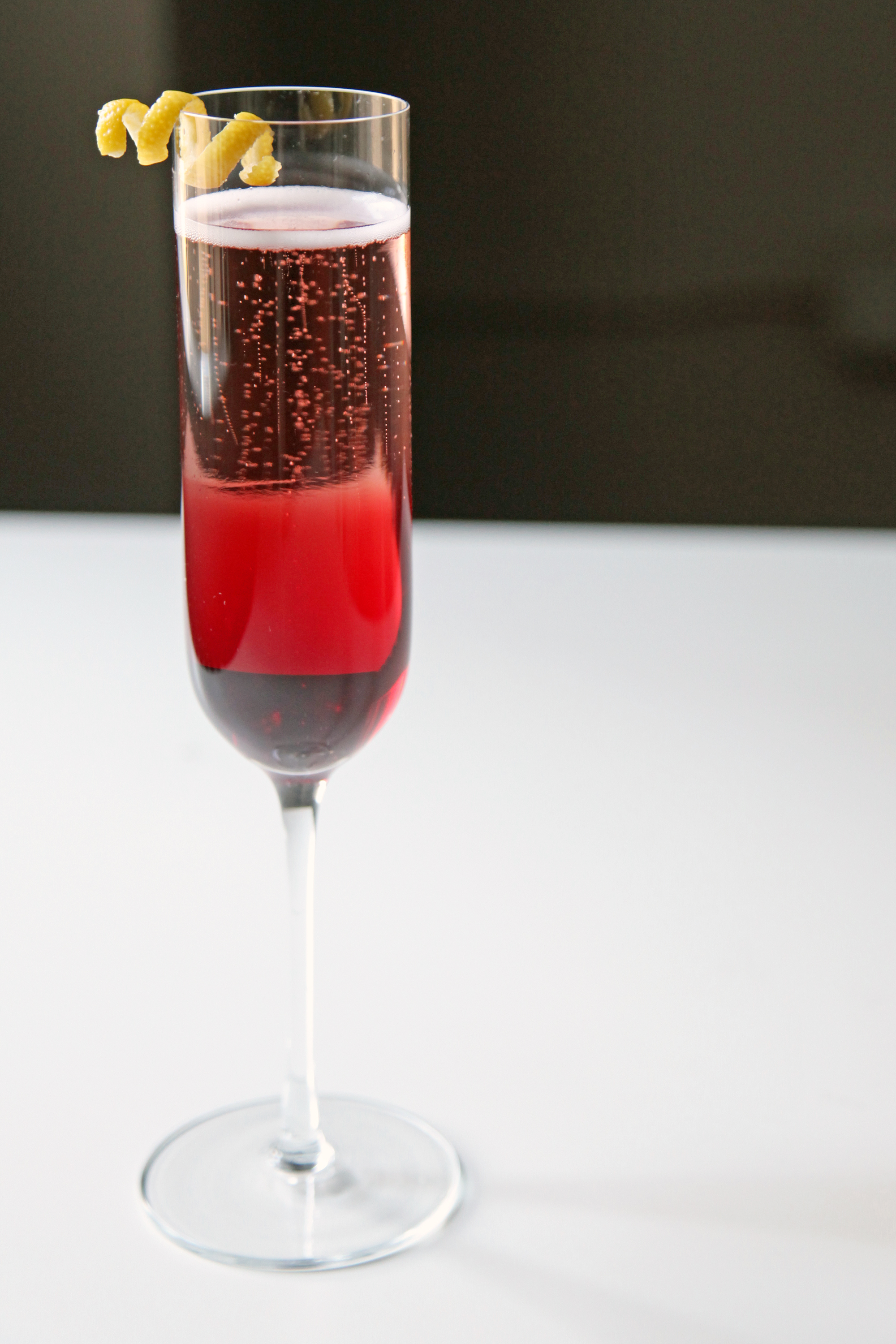 Pomegranate champagne cocktail 33 crave worthy cocktails for Champagne mixed drinks