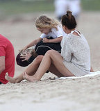 Ashlee Simpson, Bronx Wentz, and Tina Simpson laughed on the beach on the Hawaiian island of Oahu.