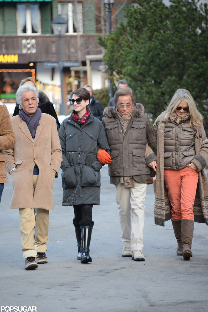 Anne Hathaway took a walk with Valentino and friends.