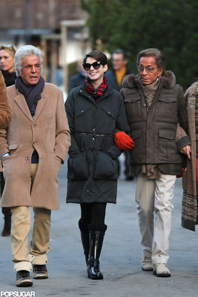 Anne Hathaway strolled with Giancarlo Giammetti and Valentino.