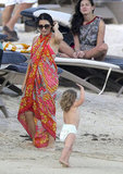 Jenna Dewan passed a cute baby on the beach.