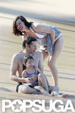 Bikini-Clad Milla Jovovich Poses Beachside With Her Family on NYE