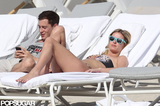 Nicky Hilton wore a bandeau bikini and blue sunglasses.