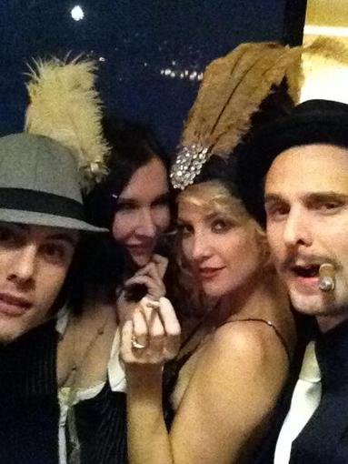 Matthew Bellamy shared a photo of he and fiancée Kate Hudson dressed up as '20s-era gangsters with their friends. Source: Twitter user MattBellamy