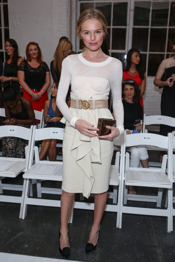 Kate was front row for Altuzarra's September 2012 runway show in a white long-sleeved dress that she cinched at the waist with a bold belt. She accessorized with a gold envelope clutch from JewelMint.