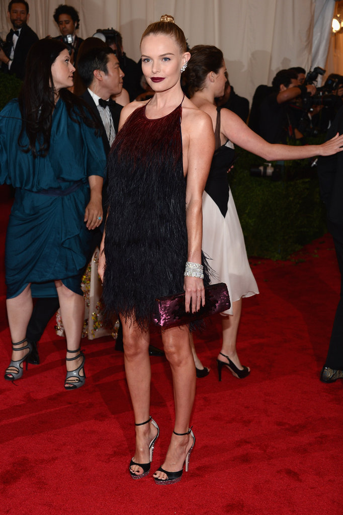 While most other stars were clad in floor-length gowns at the 2012 Met Gala, Kate proved that short and sweet could be just as glam. She shined in an ombré feathered Prada dress, which she paired with strappy sandals and a dark purple pout.