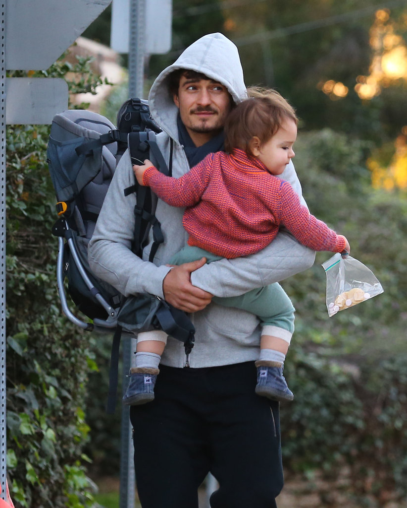 Orlando Bloom carried Flynn and a backpack.