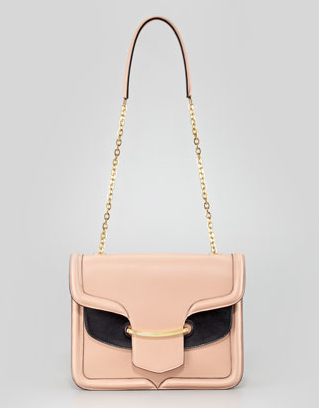 Alexander McQueen's blush and black shoulder bag ($2,545) has a retro shape, but the chain handle takes it to more contemporary places. The blush hue would look great especially in the Spring.