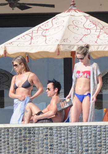 Jennifer Aniston worked a string bikini, while Emily Blunt showed off a printed bandeau and bright blue bottoms, on vacation together in Cabo.