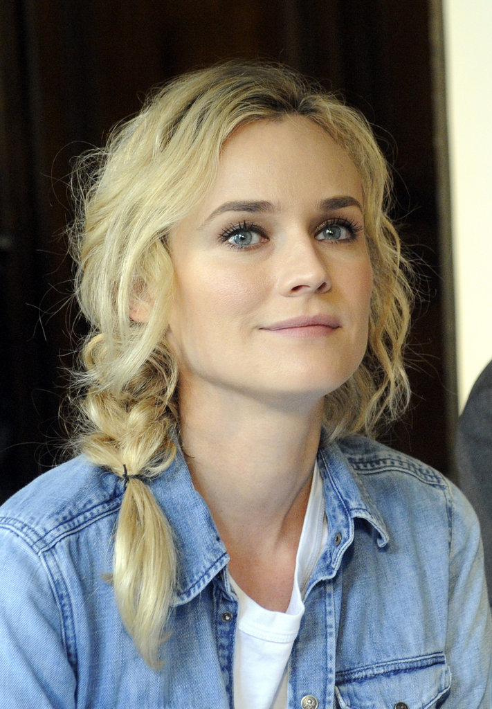 Don't have time to fuss? Just let your hair air-dry, braid it, and sweep it to the side, then. Don't be concerned with shorter strands falling out: they add to the charm. Diane Kruger's natural texture never looked so good.